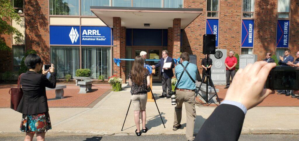 Photo: Rep. John Larson awarding ARRL CEO David Minster, NA2AA, with a commemorative plaque.